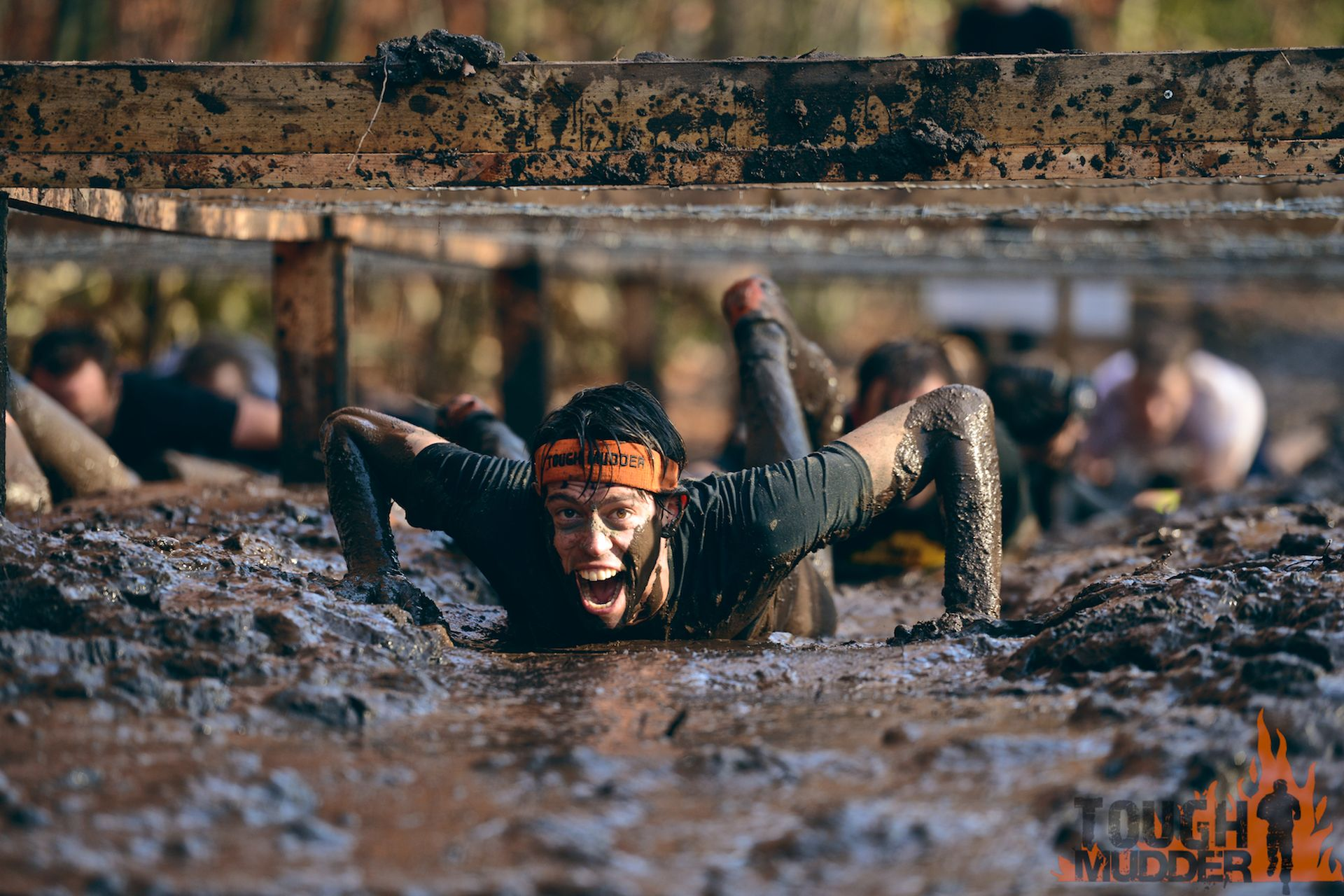 Tough Mudder is a 12 mile obstacle course designed to test all-around strength, stamina, teamwork, and mental grit.