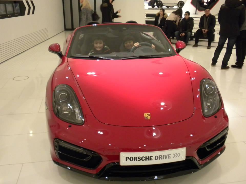 Porsche red car with kid