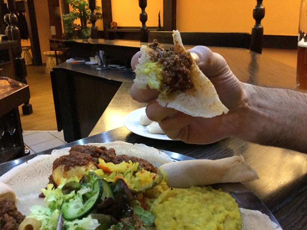 Ethopian food in hand 5