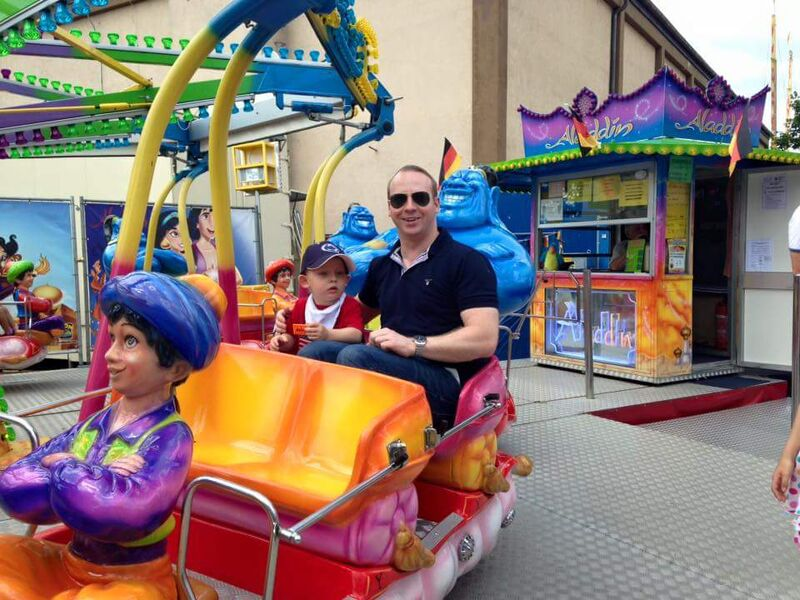 German American Fest father and child on ride