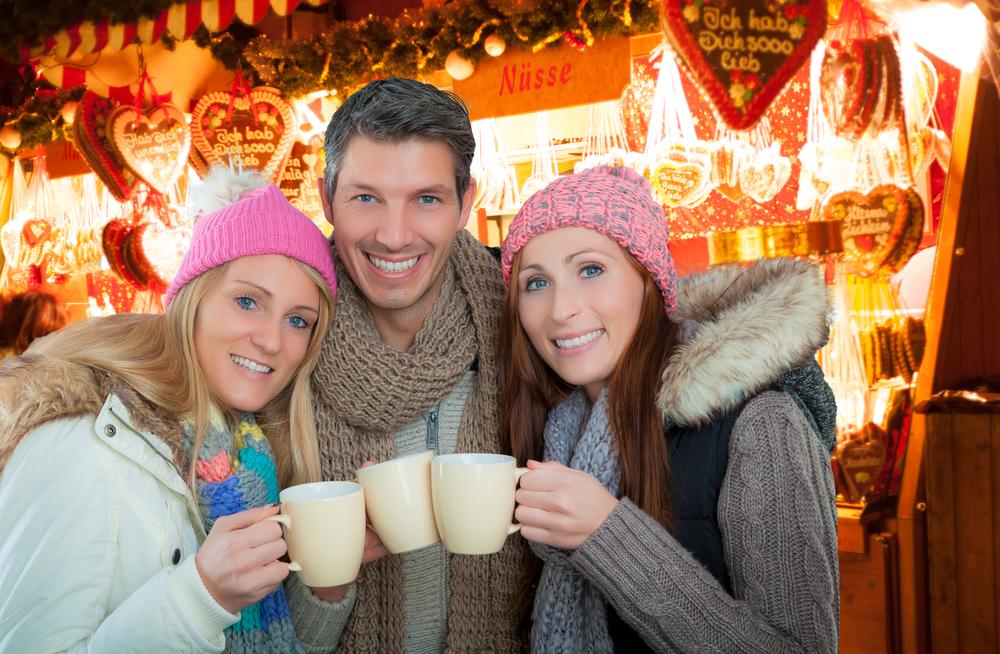 altafulla shutterstock Christmas Market enjoying hot drink